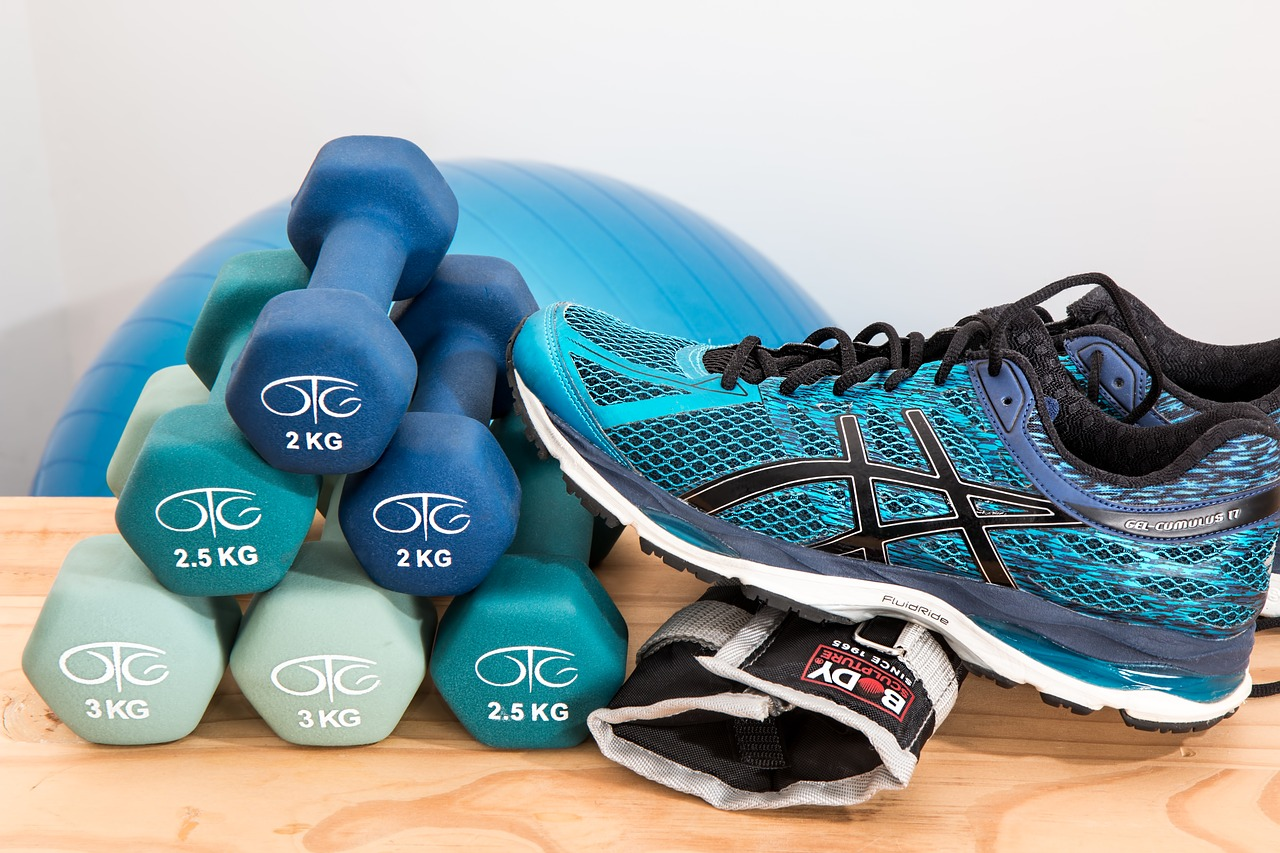 Dumbbells and a running shoe