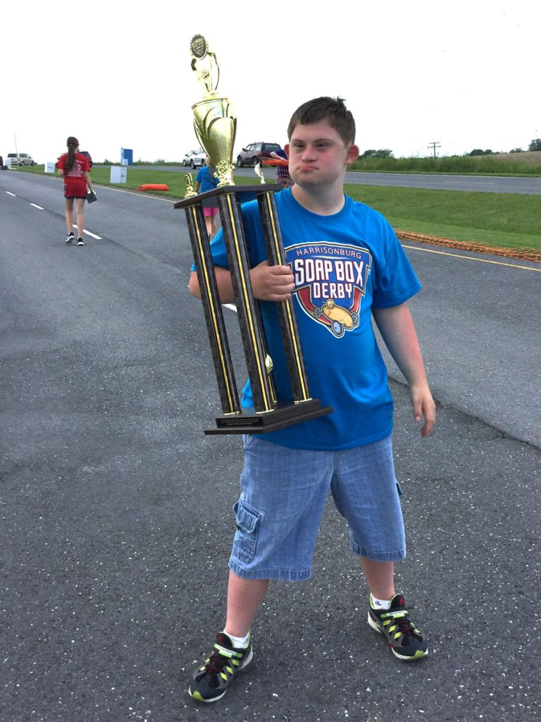 Photo of Donnie Winston holding a trophy